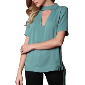 Green shirt with open front and back